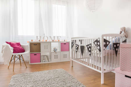 Photo of pink and white baby girl room