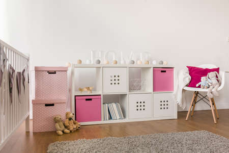 in a room: Picture of modern kids storage furniture in baby room Stock Photo