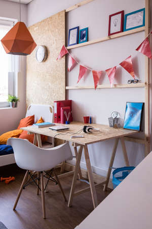 osb: Wooden desk in contemporary room for teenage boy