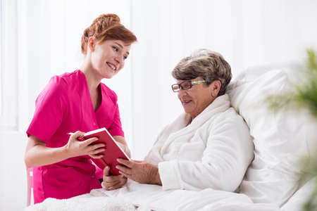 home healthcare: Picture of nursing home resident and her carer