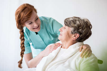 care at home: Picture of patient with alzheimer having professional care