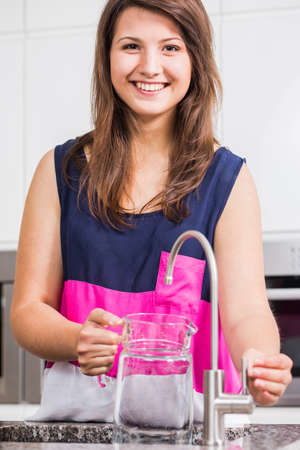 jag: Girl pouring healthy tap water to jag Stock Photo