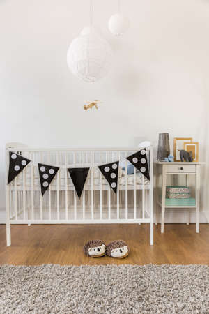 nursery room: Photo of white wooden crib in kid room Stock Photo