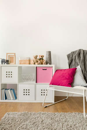 Picture of infant room with new design white cabinet