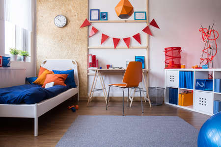 boy room: Horizontal view of modern teen boy bedroom Stock Photo