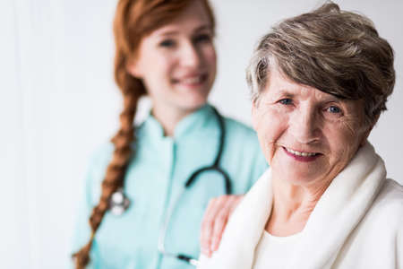 care at home: Portrait of happy patient of geriatric ward and female doctor Stock Photo