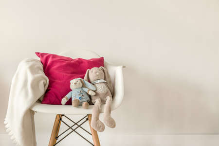 Picture of infant accessories on white modern chair