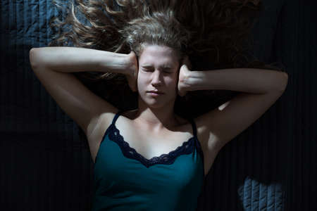 nightgown: Photo of woman with strong headache in nightgown