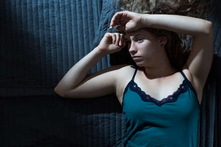 girl sick: Image of tired female relaxing in bedroom Archivio Fotografico