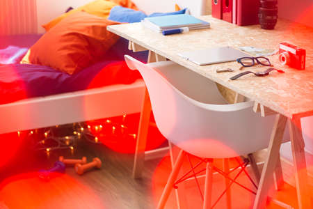 osb: Desk and bed in teen room - picture with bokeh effect