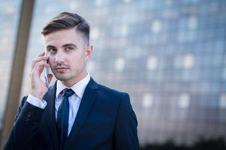 business man phone: Businessman having a phone call after work
