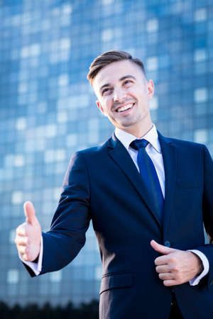 somebody: Image of young businessman greeting with somebody Stock Photo