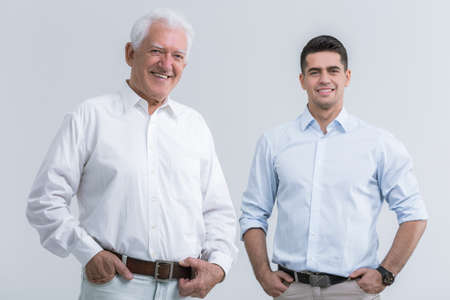 white men: Father with adult son posing to picture