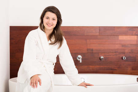 female in douche: Image of girl in modern bathroom with new bathtub Stock Photo