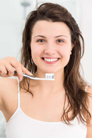 female in douche: Image of fresh smiling girl with toothbrush Stock Photo