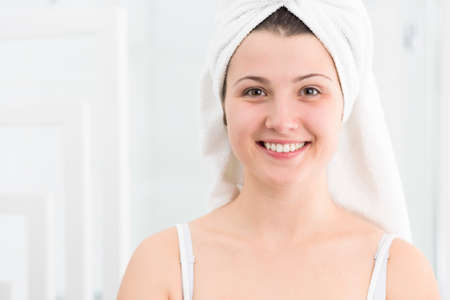 female in douche: Image of happy girl with white towel on head