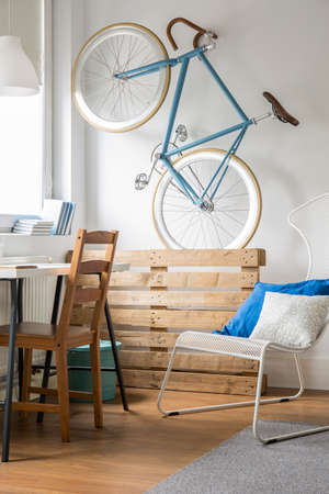 small room: Creative way to store bike in small room