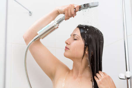 douche: Photo of young beautiful woman taking relaxing shower