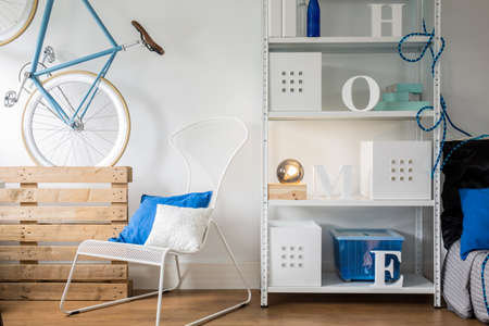 white interior: White metal furniture in small bright room