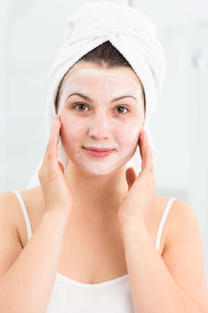 natural face: Image of spa female applying natural face mask Stock Photo