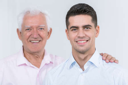 senior adult man: Picture of adult son with supporting father