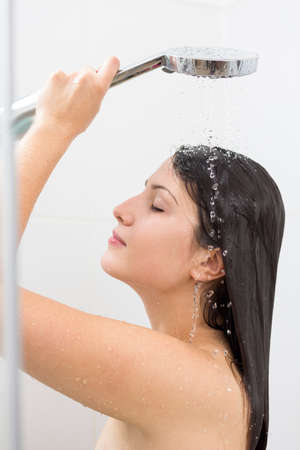 female in douche: Image of woman pampering her body with warm water Stock Photo