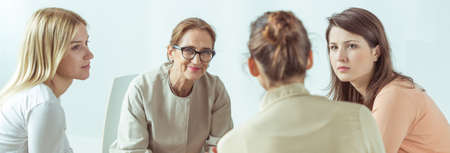therapy group: Panorama of female psychologist helping her stressed and depressed patients