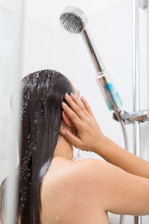 female in douche: Image of brunette woman relaxing under shower Stock Photo
