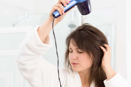hairdryer: Picture of girl in bathrobe with hairdryer