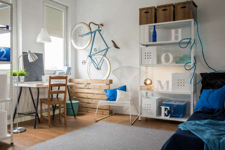 apartment interior: Small blue studio for creative young person Stock Photo