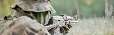 sniper training: Close-up of masked marine prepared for shooting Stock Photo