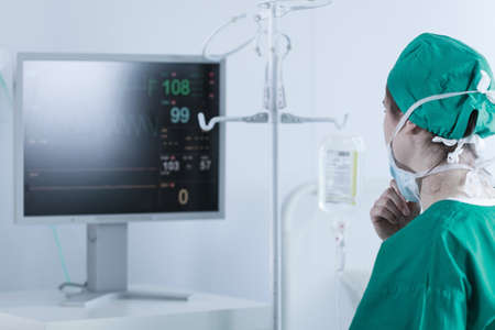 Picture of surgeon analysing patient bodily functions