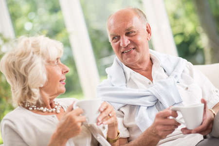 image date: Image of happy senior man on date with mature woman Stock Photo