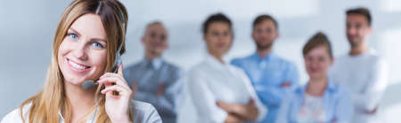 Panoramic picture of smiling call centre consultant Stock Photo