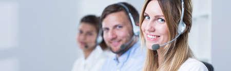 handsfree phones: Young smiling people working as helpline consultants