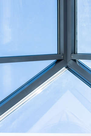 glass background: Metal construction of roof with glass window Stock Photo