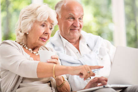 happy seniors: Photo of active elderly couple and modern technology