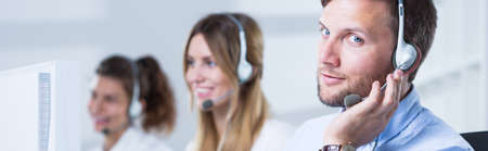 sales call: Call centre agents working in bright office