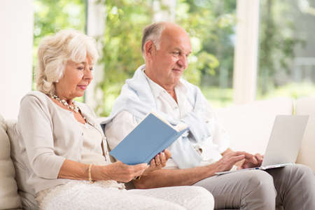 retirement: Image of retired man and woman relaxing in house