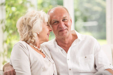 tenderness: Photo of tenderness between elderly man and woman Stock Photo