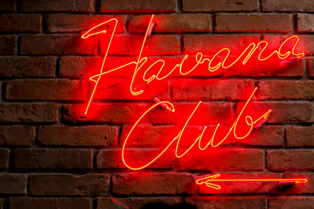 Red illuminated text - entrance to the club Stock Photo