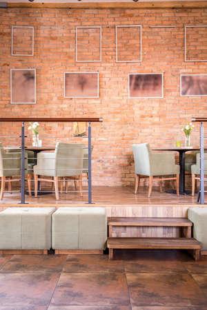 wall decor: Interior of modern restaurant in brick loft Stock Photo