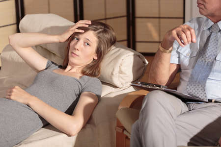 experienced: Experienced therapist is trying to find solution to patients problem Stock Photo