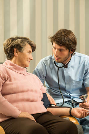 the cardiologist: Cardiologist measuring blood pressure of senior woman