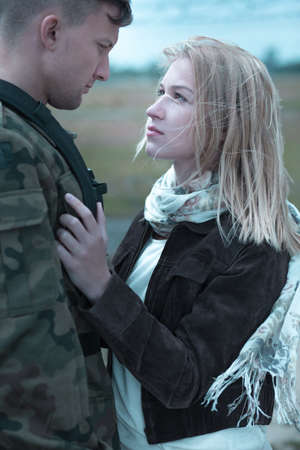 farewell: Soldier is leaving his girlfriend and going to army Stock Photo
