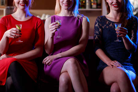 liquors: Beauty woman drinking shots in the bar Stock Photo