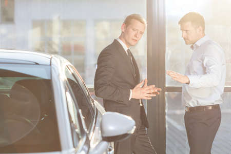 buyer: Photo of elegant automobile buyer discussing with professional seller