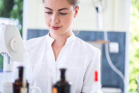 internship: Image of female microbiology student during internship in professional lab