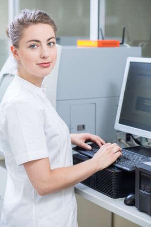 researcher: Picture of beautiful female scientist in white laboratory coat