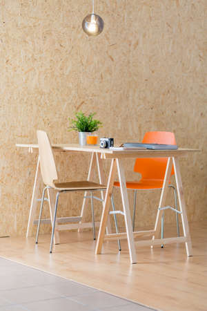 Wooden desk in contemporary studio of young photographer Stock Photo